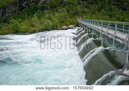 Kjosfossen dam. Upper point of famous huge norwegian waterfall, popular travel destination. Aurland, Flam, Norway
