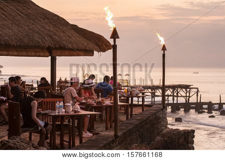Bali, Indonesia - September 18, 2016 -  People eating in the famous Rock Bar on Bali, Indonesia