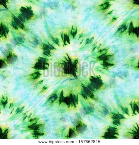 Seamless tie-dye pattern of green and blue color on white silk. Hand painting fabrics - nodular batik. Shibori dyeing.