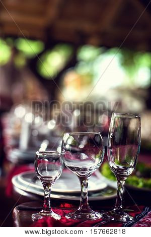 Close up picture of empty glasses in restaurant.