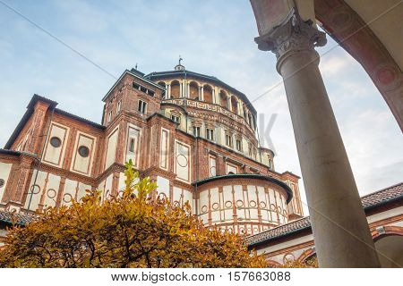 Italian church Santa Maria Delle Grazie in Milan, Italy, from courtyard in autumn.