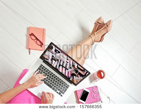 Woman watching online tutorial on laptop. Makeup and beauty blog.