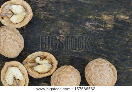Walnuts, Walnuts Close-up, Walnuts On A Dark Background, Walnuts On A Wooden Table, Walnuts On A Dar
