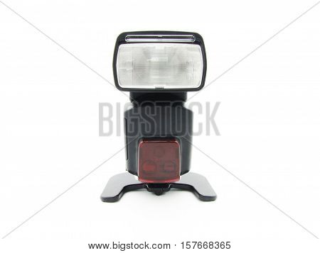 flash for the camera with an adjustable head on a white