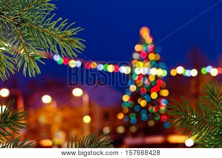 Christmas background with unfocused Christmas tree by night