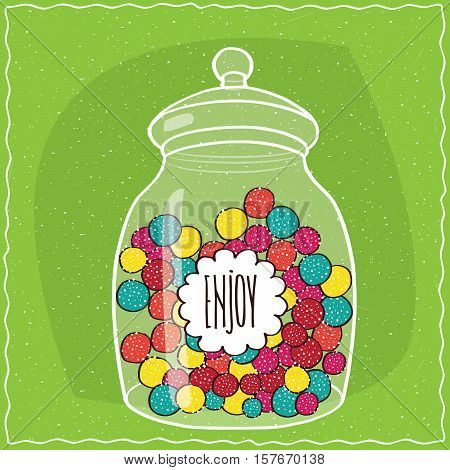Glass Jar With Colorful Round Candies Inside