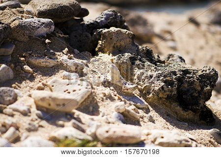 Interesting rock formation. Stones and sand at the beach