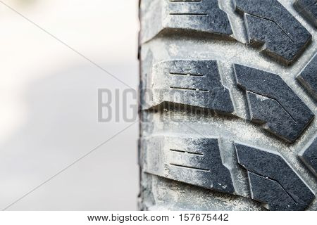 Detail Of Old Off-road Vehicle Tire With Beautiful Sunlight.