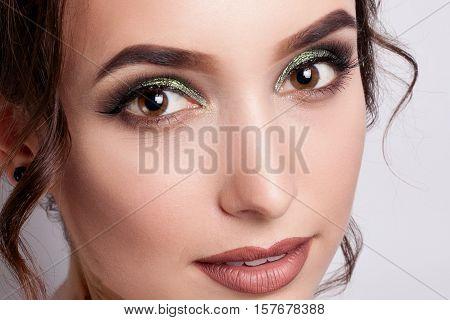 people luxury make-up and fashion concept - Glamorous female portrait close up. Makeup emerald green long eyelashes perfect skin