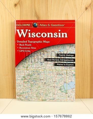 RIVER FALLS,WISCONSIN-NOVEMBER 21,2016: A copy of the Wisconsin Atlas and Gazeteer with a wood background.