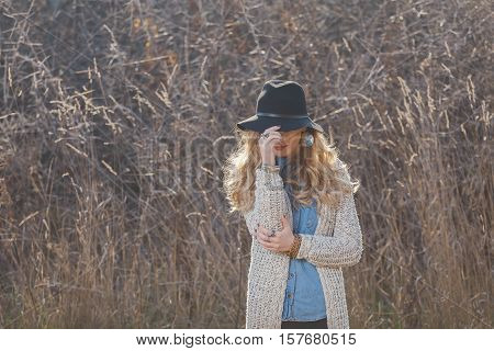 Portrait of a hippie young woman wearing a hat
