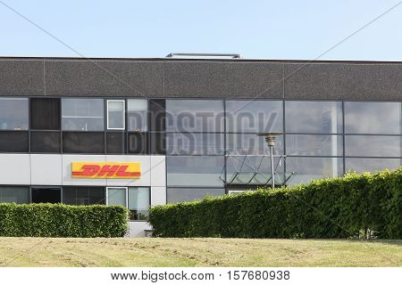 Skanderborg, Denmark - May 26, 2016: DHL building and office. DHL Express is a division of the german logistics company Deutsche Post DHL providing international express mail services