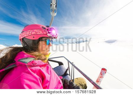 Young sporty girl skier chairlift ski resort during the Christmas holidays
