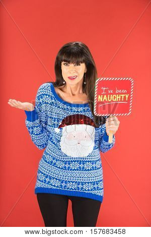 Confused Woman Holding Naughty Sign