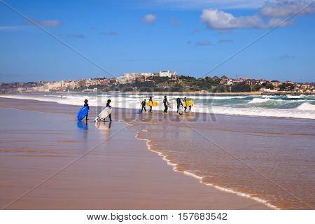 SANTANDER SPAIN - AUGUST 20: Surfer people carrying their surfboard on the beach on August 20 2016