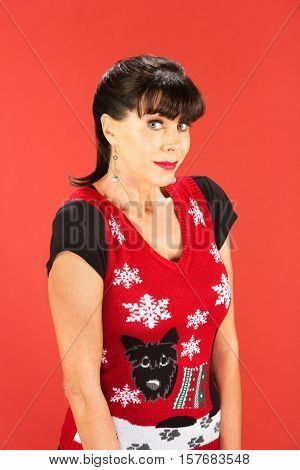 Grinning Adult Female In Ugly Christmas Sweater