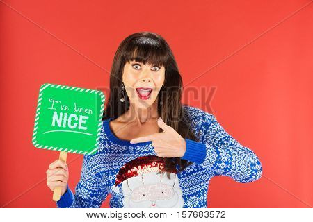 Happy Woman Pointing To A Nice Sign