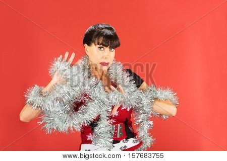 Uncomfortable Woman Wrapped In Silver Tinsel