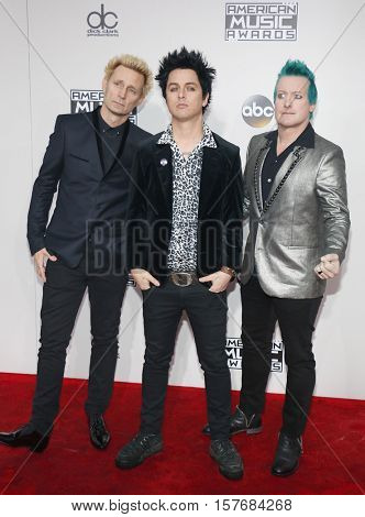 Mike Dirnt, Billie Joe Armstrong, Tre Cool of Green Day at the 2016 American Music Awards held at the Microsoft Theater in Los Angeles, USA on November 20, 2016.