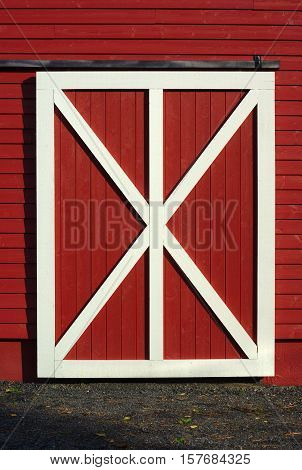 door of cowshed red barn white plank closeup wood shed