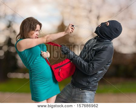 Self Defense Concept. Young Woman Is Spraying With Pepper Spray