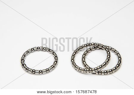 Metallic bicycle bearings on a white background