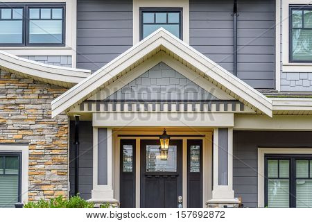 A perfect neighborhood. Houses in suburb at Fall in the north America. Fragment of a luxury house with entrance door and nice window. poster
