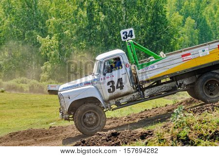 Tyumen, Russia - July 5, 2009: Championship of Russia on truck autocross in the Silkin Ravine. Trucks racing on unpaved track