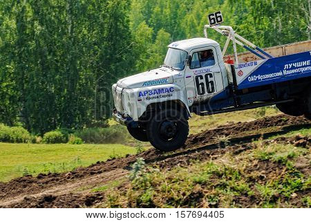 Tyumen, Russia - July 5, 2009: Championship of Russia on truck autocross in Silkin Ravine. Trucks racing on unpaved track