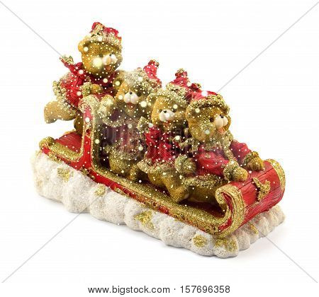 Handmade Christmas Bears In Sleigh In Red And Gold Jackets And Hats On Snow Isolated On White With S