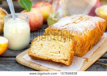 Yoghurt cake with olive oil apples and powdered sugar