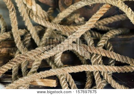 Old tangled yellow rope on the background of brick