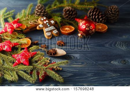 Christmas Gingerbread Cookies Against Background Branch Of Fir Tree And Sparks Of Christmas Garland