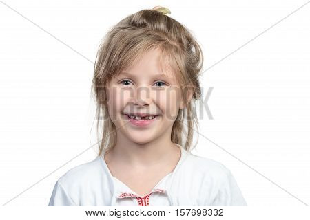 Portrait of a beautiful smiling child girl with no front teeth isolated on white background