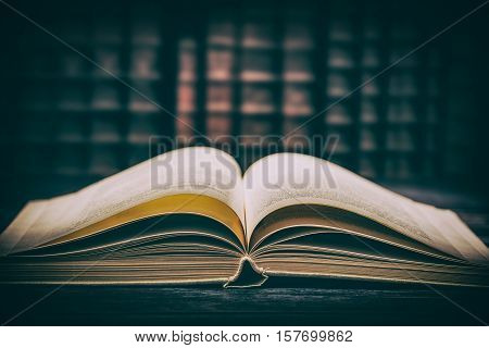 book open old wisdom desk read religion parchment literature table fiction dictionary history used historic wooden school concept - stock image