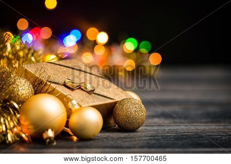 present holiday gift background christmas decoration box glossy celebration gold golden xmas wooden shiny color concept - stock image
