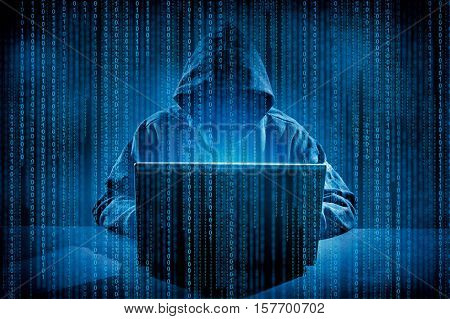 Hacker using laptop. Hacking the Internet.High resolution image.