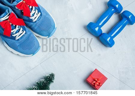 Christmas Sport Composition With Shoes, Dumbbells And Red Gift Box