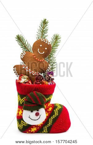 Christmas cookies in a sock isolated on white background