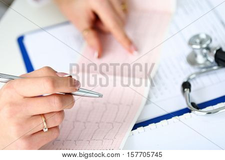 Doctor Hands With Cardiogram Chart On Clipboard Pad