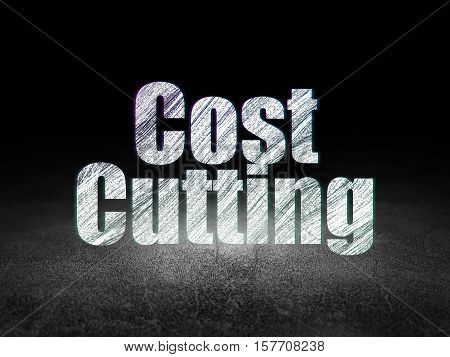 Business concept: Glowing text Cost Cutting in grunge dark room with Dirty Floor, black background