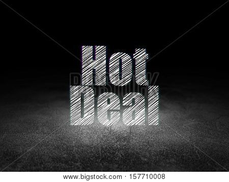 Finance concept: Glowing text Hot Deal in grunge dark room with Dirty Floor, black background