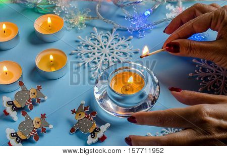 New Year And Christmas. Light The Festive Candles.