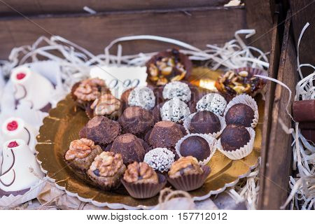 delicious mouthwatering chocolates on the counter outdoors