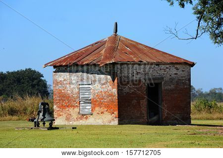 Old brick building with rusting tin roof sits at the back of the Lakeport Plantation in Eastern Arkansas.