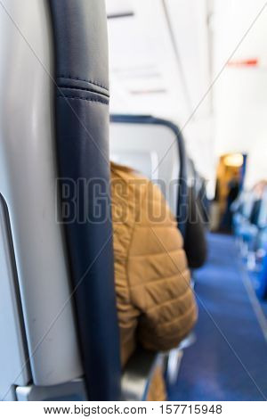Airplane Headrest Seat Behind Isle Depth of Field Bokeh Blue Leather Texture