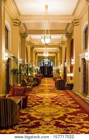 Elegant Luxurious Hallway Upscale Ritsy Hotel Carpeting Lights Illuminated Warm Cozy