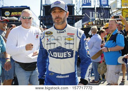 Homestead, FL - Nov 18, 2016: Jimmie Johnson (48) signs autographs on the way to practice for the FORD EcoBoost 400 at the Homestead-Miami Speedway in Homestead, FL.