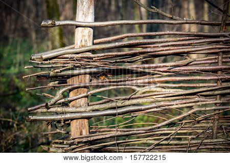 abstract wattle wooden fence in garden