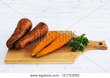 Boiled Carrots And Parsley On Board